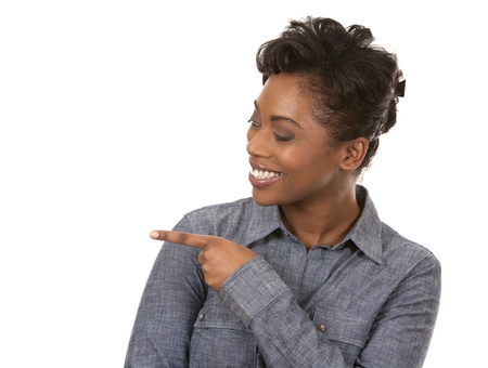 pretty casual black woman pointing with her arm on white background Stock Photo - 18468174