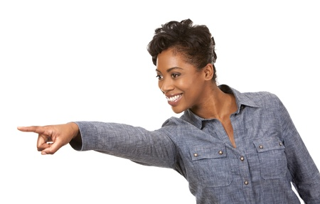 pretty casual black woman pointing with her arm on white background Stock Photo - 18453242