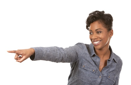 pretty casual black woman pointing with her arm on white background Stock Photo - 18468157