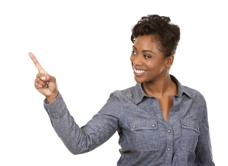 pretty casual black woman pointing with her arm on white background Stock Photo - 18468154