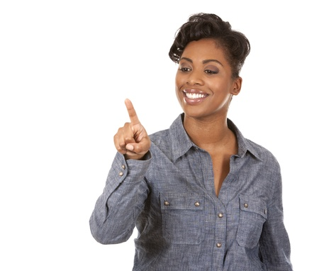 pretty casual black woman pointing with her arm on white background Stock Photo - 18468166