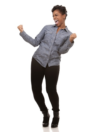 pretty casual black woman is very happy on white background