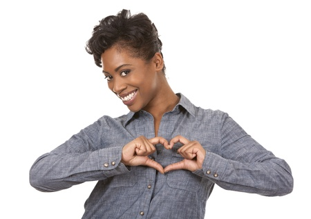 pretty black woman showing heart sign on white background Stock Photo - 18468175