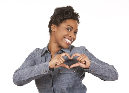 pretty black woman showing heart sign on white background Stock Photo - 18468167