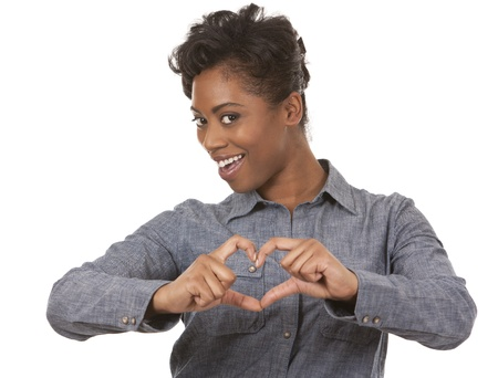 pretty black woman showing heart sign on white background Stock Photo - 18468171