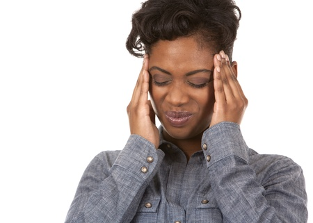 casual black woman with headache on white background photo