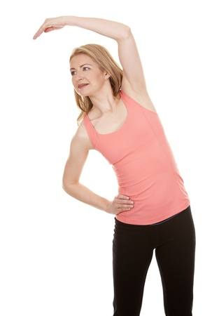 pretty blonde wearing active wear on white background Stock Photo - 18574501