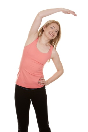 pretty blonde wearing active wear on white background Stock Photo