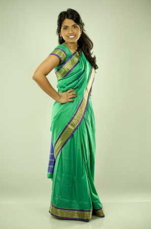 pretty asian woman wering green indian outfit photo