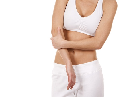 female elbow: brunette holding her elbow on white isolated background