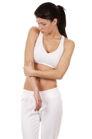 brunette holding her elbow on white isolated background