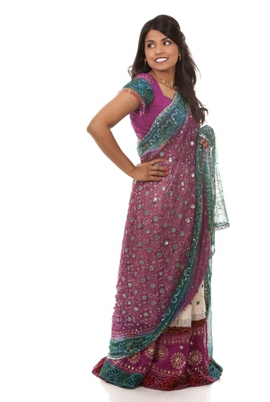 pretty woman wering indian outfit on white background photo