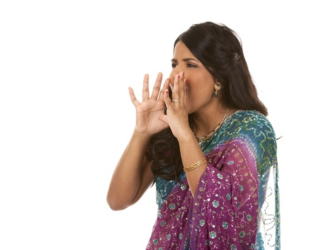 indian saree: pretty indian woman shouting on white isolated background