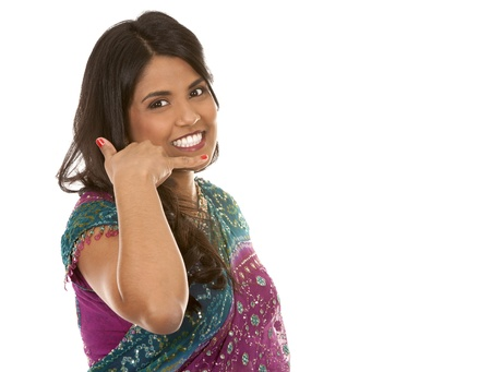 bellydance: pretty indian woman showing call me gesture on white isolated background