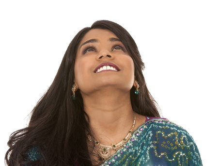 pretty indian woman looking up on white isolated background Stock Photo - 18788628