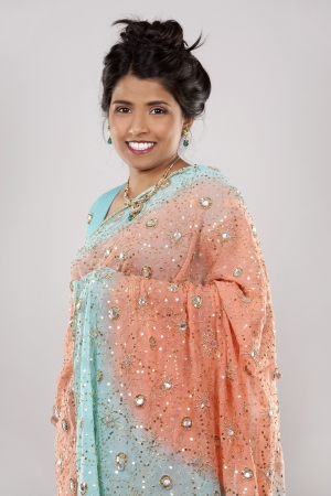 woman wering indian outfit on light grey background Stock Photo - 18788622