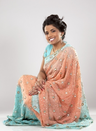 woman wering indian outfit on light grey background Stock Photo - 18788621