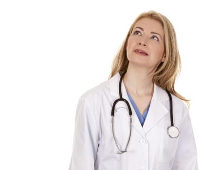 blond female doctor posing on light grey background Stock Photo - 18843540