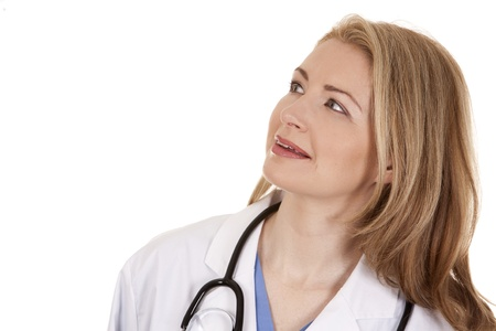 blond female doctor posing on light grey background Stock Photo - 18843548