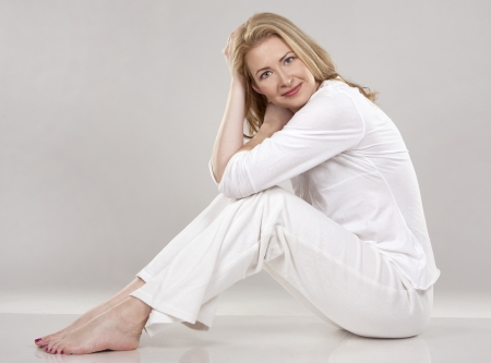 pretty blond wearing white outfit on light background Stock Photo - 18843547
