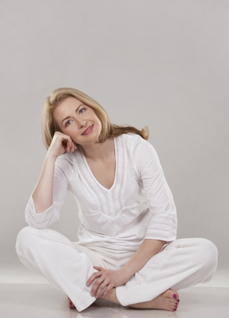 pretty blond wearing white outfit on light background Stock Photo - 18843550
