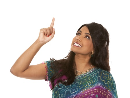 pretty indian woman pointing on white isolated background Stock Photo - 18913149