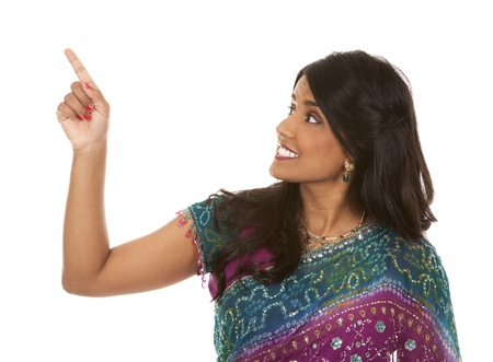 pretty indian woman pointing on white isolated background Stock Photo - 18913157