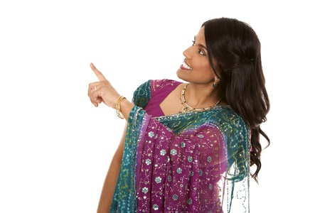 pretty indian woman pointing on white isolated background Stock Photo - 18913160