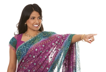 pretty indian woman pointing on white isolated background Stock Photo - 18913162