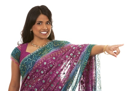 pretty indian woman pointing on white isolated background Stock Photo - 18913116