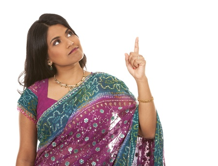 pretty indian woman pointing on white isolated background Stock Photo - 18913159