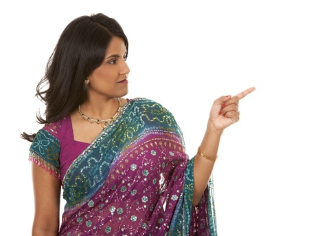pretty indian woman pointing on white isolated background photo