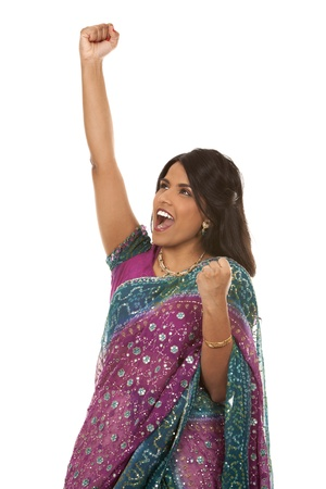 pretty indian woman  winning on white isolated background photo