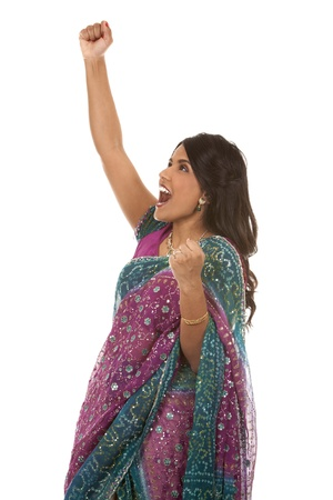 pretty indian woman  winning on white isolated background Stock Photo - 18913119