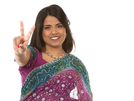 pretty indian woman showing peace on white isolated background Stock Photo - 18913107