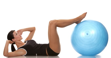 fit ball: female fitness model exercising with blue ball Stock Photo