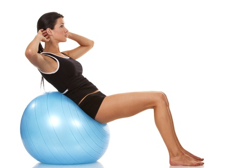 female fitness model exercising with blue ball Stock Photo - 19063490