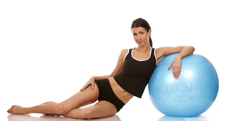 female fitness model posing with blue exercise ball  Stock Photo - 19091760