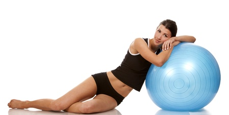 female fitness model posing with blue exercise ball Stock Photo - 19091756