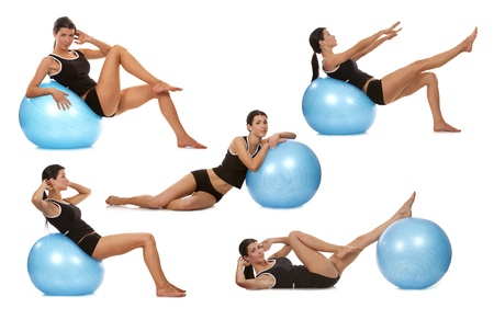excercise: female fitness model exercising with blue ball Stock Photo