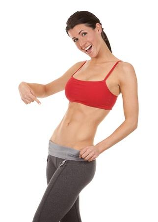 skinny woman: pretty brunette wearing active wear on white background