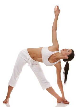 Hübsche Brünette ist die Ausübung von Yoga auf weißem Hintergrund Standard-Bild - 19147621