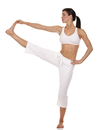 pilates man: pretty brunette is exercising yoga on white background