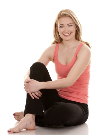 pretty blonde wearing active wear on white background photo