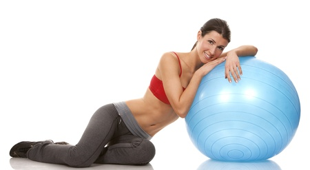 pretty brunette wearing active wear on white background Stock Photo - 19356870