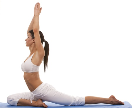 female pose: pretty brunette is exercising yoga on white background