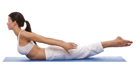 pretty brunette is exercising yoga on white background Stock Photo - 19356876