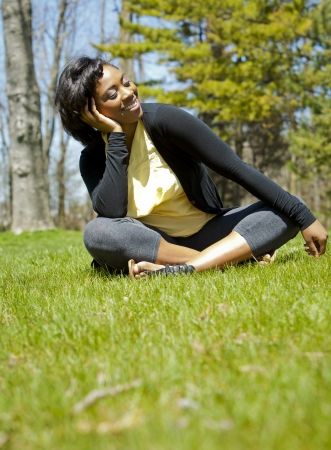 pretty black woman enjoying summer in the park Stock Photo - 19407068