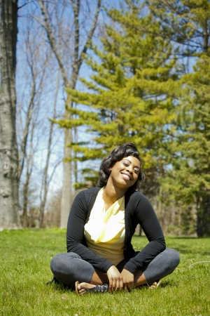 pretty black woman enjoying summer in the park Stock Photo - 19407071