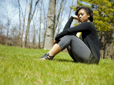 pretty black woman enjoying summer in the park Stock Photo - 19407070